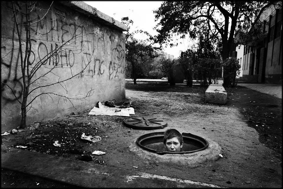 ODESSA, UKRAINE - NOVEMBER 15 2005:  Street children of Ukraine. A group of street kids living in an underground sewer on the north side of Odessa. Pictured is 14 year old Andrey who was abandoned by is alcoholic parents 5 years ago. (Photo by David Gillanders)